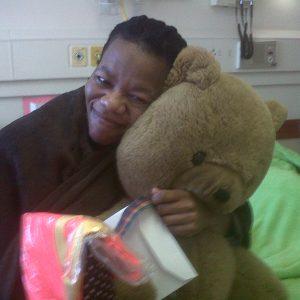 Olwethu's mom, Mhiza in her Mega-hug with Robbie-bear